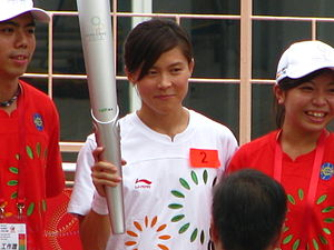 2009 East Asian Games - Swimmer Sherry Tsai holds the relay torch