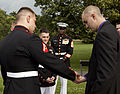 Honorary Marine Daran Wankum, right, receives Eagle Globe and Anchor pins from Marines of Marine Barracks Washington following a wreath laying ceremony at the Marine Corps War Memorial in Arlington, Va, June 13 130613-M-KS211-025.jpg