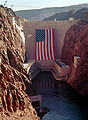 Hoover dam with large American flag.jpg