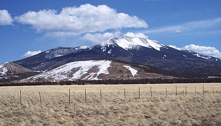 Humphreys Peak seen on its western side from U.S. Route 180, with Agassiz Peak in the background Humphreys Peak western side.jpg
