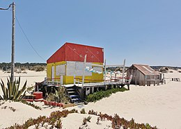Hut fishermen (cabana de pescador) at Praia da Saúde beach, Costa da Caparica, Portugal.JPG