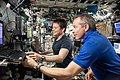 ISS-59 Anne McClain and David Saint-Jacques train inside the Destiny lab (1).jpg