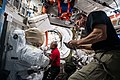 ISS-64 Glover and Hopkins work inside Quest airlock.jpg