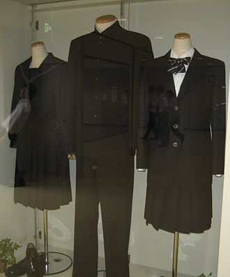 Japanese school uniform - Museum exhibit of the uniforms of the Ichikawa Gakuen school. The middle mannequin is displaying a gakuran.