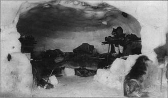 Igloo - An Inuk inside an igloo, early-20th century.