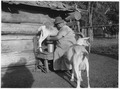 Indian woman milking a goat - NARA - 285903.tif