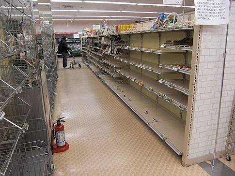 Empty instant noodle shelves in a supermarket in Tokyo due to stock being bought out on March 16, 2011, 5 days after the earthquake. Image: Kellykaneshiro.