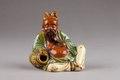 Japansk figur från 1800-talet föreställande lyckoguden Ho-Tei - Hallwylska museet - 96047.tif