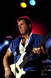 John Wetton playing bass live.jpg