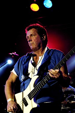 John Wetton playing bass live.jpg