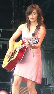 Tunstall performing at the 2005 Glastonbury Festival with her Gibson Dove guitar.