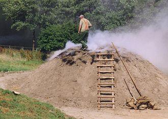 Charcoal burner - A charcoal burner at his charcoal pile