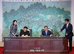 Kim Jong-un and Moon Jae-in seated at a table