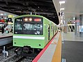 Kuha200-119 Osaka Higashi Line at Shin-Osaka Station.jpg