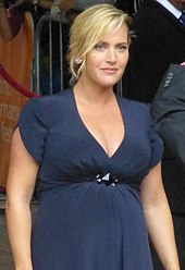 A pregnant Kate Winslet poses for the camera.