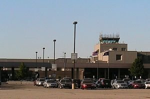 Capital Region International Airport - Airport terminal with short term parking lot in foreground