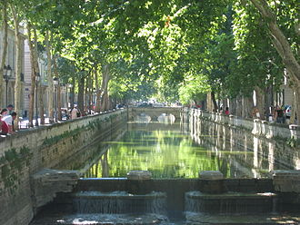 Les Quais de la Fontaine, the embankments of the spring that provided water for the city, the first civic gardens of France, were laid out in 1738-55. Les Quais de la Fontaine.jpg