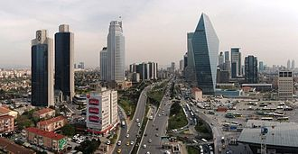 Levent - Büyükdere Avenue in Levent, with the Finansbank headquarters (formerly Soyak Crystal Tower) at right.