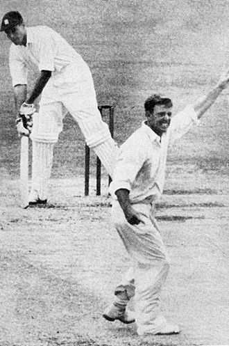 Ray Lindwall - Lindwall traps Peter May LBW in the First Test against England, 1954–55.