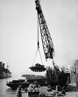 Fleet and Industrial Supply Center, Oakland - USMC tanks are loaded on a barge at the NSC Oakland, 1950.