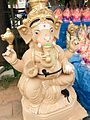 Lord Ganesha Photos - An eco friendly Ganesh Murti for sale at a Ganesh Chaturthi makeshift shop.jpg
