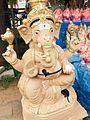 Lord Ganesha Photos - An eco friendly Ganesh Murti for sale at a Ganesh Chaturthi makeshift shop.jpg