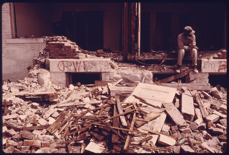 File:MEMBER OF A WRECKING CREW RESTS DURING DEMOLITION OF HOUSING IN THE MULKEY SQUARE AREA. MANY OF THE LOW INCOME... - NARA - 557351.jpg