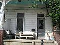 Magazine Street Jessie James Garner Bldg Sept 2009 4907 Porch.JPG