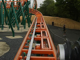 Brake run - Magnetic brakes on the same roller coaster shown above, located before the friction brakes. These track-mounted fins can be retracted to allow the train to pass without slowing it down.