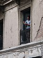 Man eating on a Montevideo balcony.jpg