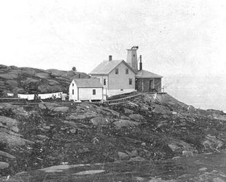 Monhegan, Maine - The former Coast Guard fog signal station on Manana Island, across a narrow passage from Monhegan