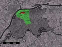 The town centre (red) and the statistical district (light green) of Wamel in the municipality of West Maas en Waal.
