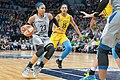 Maya Moore (23) handles the ball around Gabby Williams (15).jpg