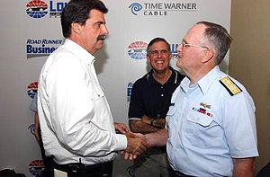 Mike Helton - Helton (left) meeting with Admiral Thomas Collins in 2005