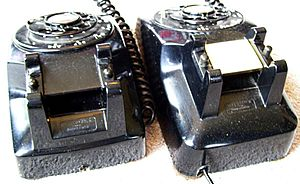 Model 5302 telephone - While very similar to the model 500, the 5302 (left phone) had a shorter base as it lacks the 500's bustle behind the handset.