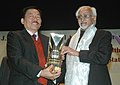 Mohd. Hamid Ansari presenting the 4th JRD Tata Memorial Award to the Chief Minister of Sikkim, Mr. P.K. Chamling, for 'Population and Reproductive Health Programme', organised by the Population Foundation of India.jpg
