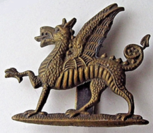 Monmouthshire Regiment cap badge.png