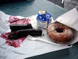 Mustamakkara - Mustamakkara with lingonberry jam, milk, and a doughnut.