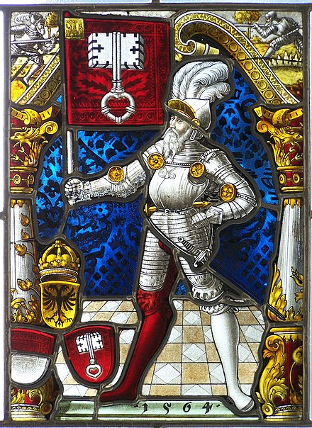 Swiss armourial glass of the Arms of Unterwalden, 1564, with typical painted details, extensive silver stain, Cousin's rose on the face, and flashed ruby glass with abraded white motif Muzeum Sulkowskich - Zabytkowy Witraz.jpg