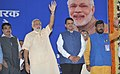 Narendra Modi at public meeting to mark Bhoomi Pujan of Dahisar-DN Nagar & Dahisar-Andheri Metro & Dr. Babasaheb Ambedkar Memorial, in Mumbai. The Chief Minister of Maharashtra, Shri Devendra Fadnavis.jpg