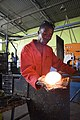 Nathi-Shongwe forming glass with a pad of wet newspaper.jpg