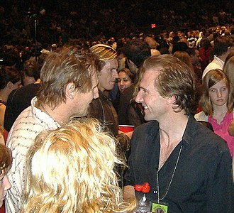 Liam Neeson - Neeson and Ralph Fiennes at a U2 concert in Madison Square Garden in October 2005