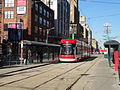 New streetcar 4404 heading south on Spadina, near King, 2014 12 20 (7) (15885286630).jpg