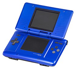 An open, electric blue oreeginal Nintendo DS seestem.