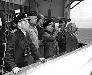 Senior officers aboard the USS Augusta during the Normandy Invasion. General Omar Bradley is the second man from the left.