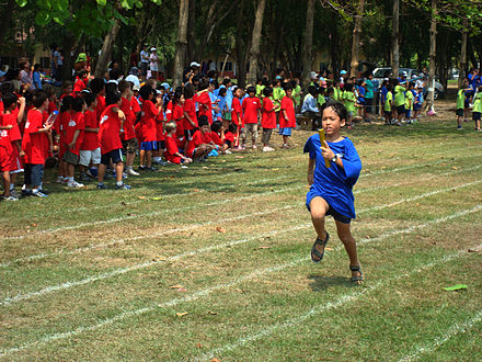 A child taking part in a local schools meeting in Cambodia - Track and field