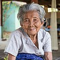 Old woman of Don Puay white shirt grey hair wrinkled skin.jpg