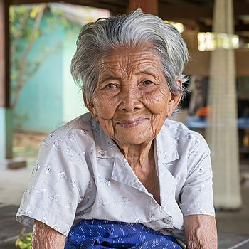 Old woman grey hair wrinkled skin from Laos