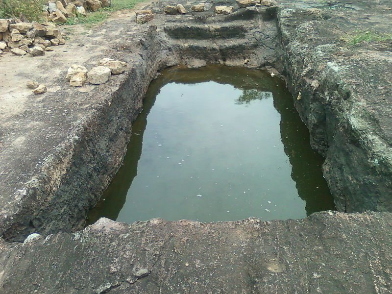 File:One of the 16 rockcut cisterns at Pavurallakonda Bheemili.jpg