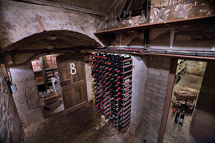 Wine bottles stored in a wine cellar at Jesus College, Oxford